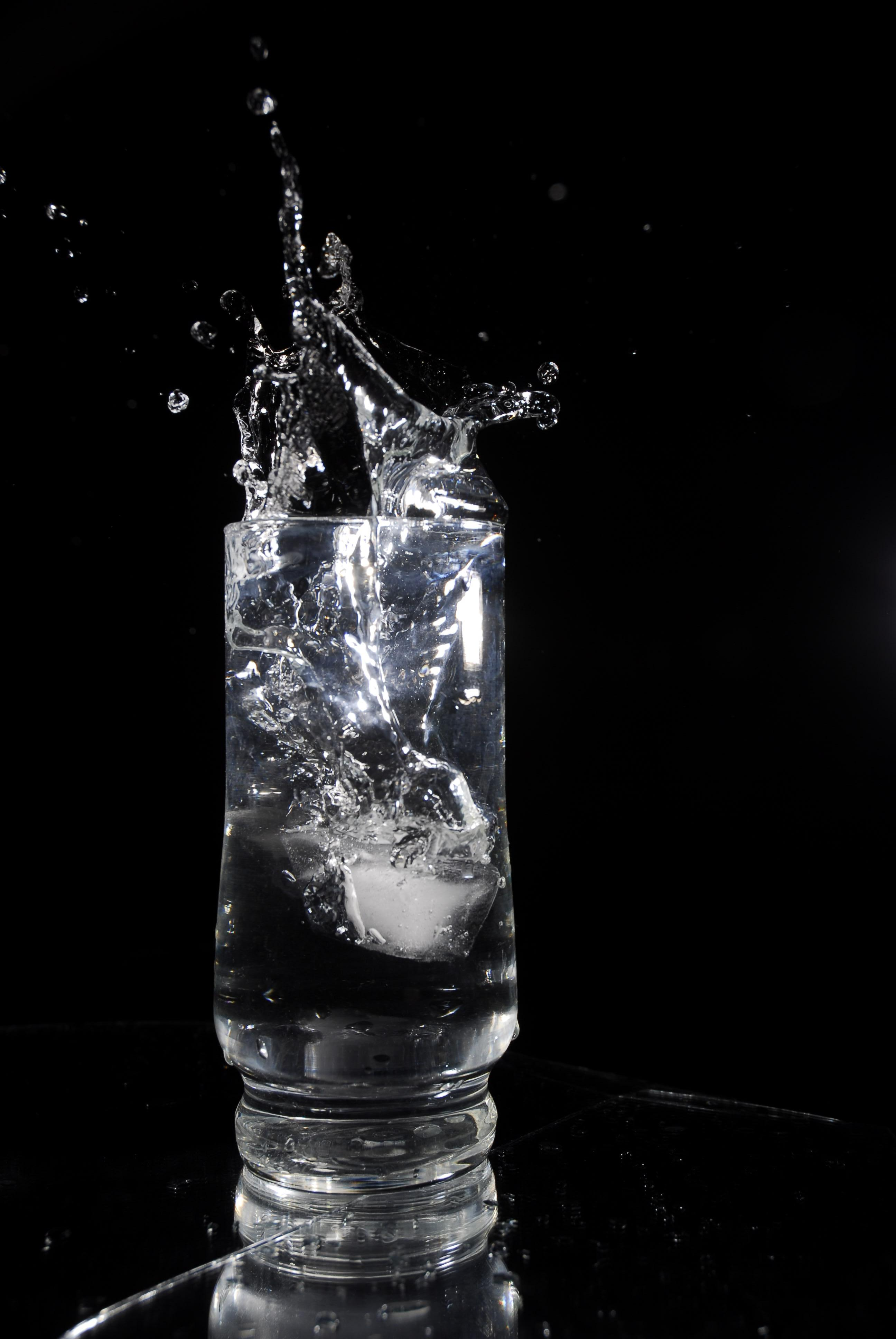 ice-cube-dropping-into-a-glass-of-water-1-1322564